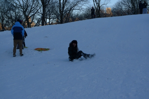 """My little Snow Bunny on the """"sled"""" we found. Who knew fast food trays were perfectly adequate snow toys?"""
